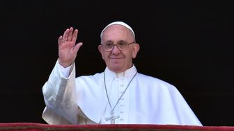 Pope Francis waves from the balcony of St Peter's basilica during the traditional 'Urbi et Orbi' Christmas message to the city and the world, on December 25, 2015 at St Peter's square in Vatican. Pope Francis was expected to appeal for reconciliation of fractured communities in his Christmas Day blessing Friday, as the world takes stock of a year of violence and suffering that saw hundreds of thousands flee their homes.   AFP PHOTO / VINCENZO PINTO / AFP / VINCENZO PINTO        (Photo credit should read VINCENZO PINTO/AFP/Getty Images)