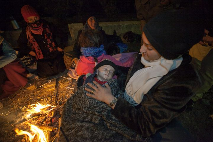Sarandon meets a tentless family in Moria Camp, a temporary settlementfor migrants and refugees.