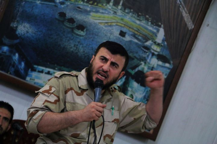 Zahran Alloush, head of the Jaish al-Islam (Islam Army) Syrian rebel group, speaks during the wedding of a fighter in the gro
