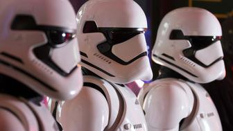 Fans wear Storm Trooper costumes ahead of the first public screening of Walt Disney Co.'s 'Star Wars: The Force Awakens' at TOHO Cinemas Roppoing Hills in Tokyo, Japan, on Friday, Dec. 18, 2015. Box-office analysts project that The Force Awakens will easily haul in more ticket revenue than any other film in the Star Wars franchise. Photographer: Tomohiro Ohsumi/Bloomberg via Getty Images