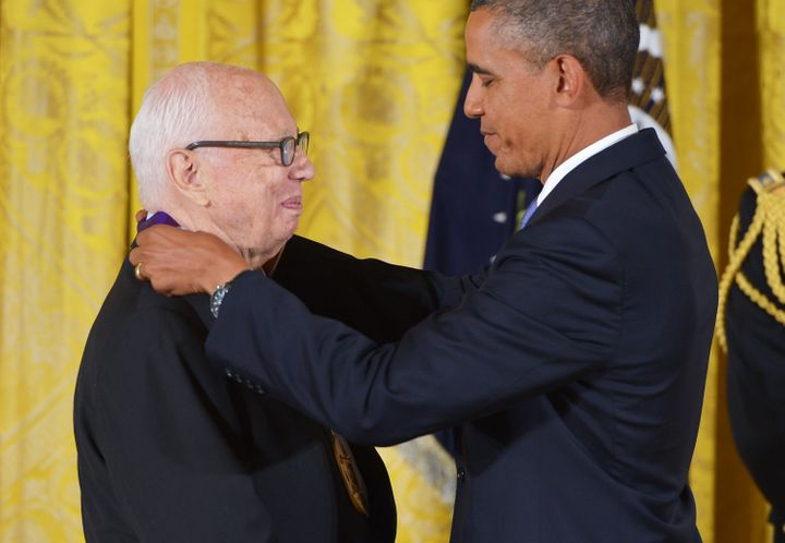 President Barack Obama presents the 2012 National Medal of Arts to Kelly at the White House in July 2013