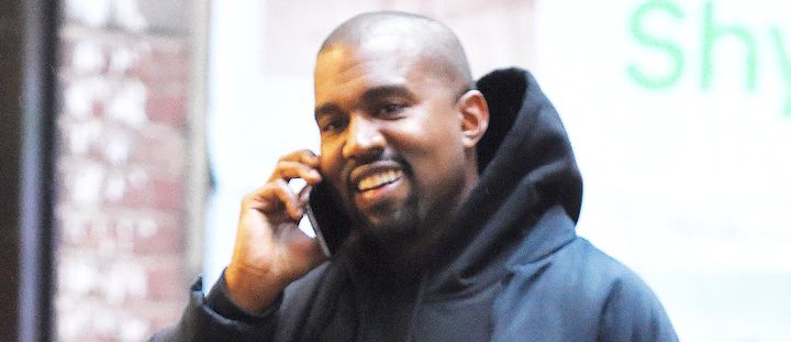 Kanye West with rare smile, probably ordering more presents.