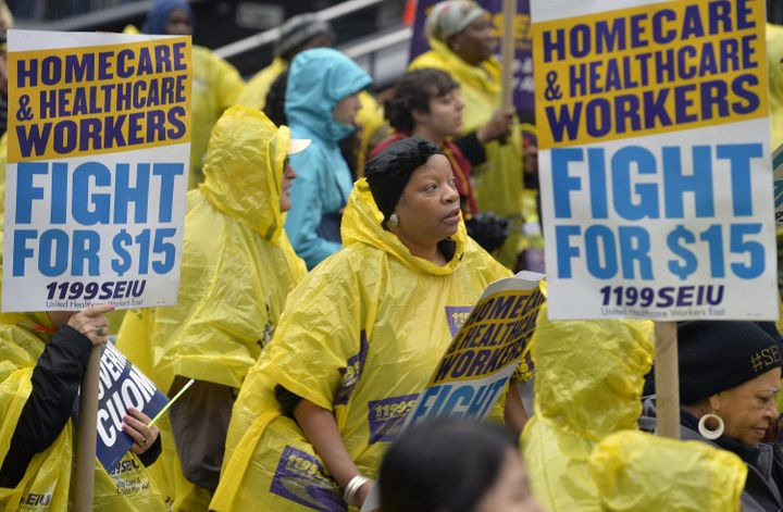 People attend the strike in support of a $15-per-hour minimum wage in New York City on Nov. 10, 2015.