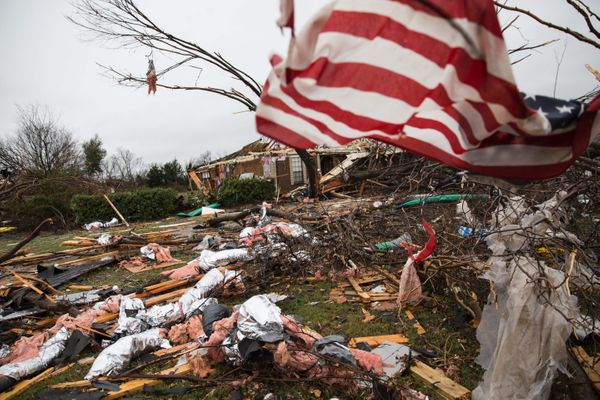 An American flag placed by first responders is seen on Dec. 27, 2015 in the aftermath of a tornado in Rowlett, Texas.