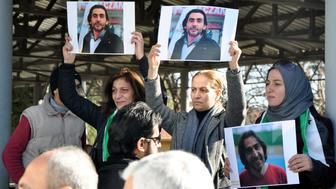 Women hold pictures of film maker Naji Jerf, who was killed on December 27, during his funeral in Gaziantep on December 28, 2015.  Naji Jerf, a Syrian activist who produced documentaries hostile to the Islamic State group, was assassinated in Turkey on December 27, according to the group with which he worked, 'Raqa is Being Slaughtered Silently'. RBSS is a group of citizen journalists who work to expose human rights abuses in Raqa, the northeastern city that IS uses as its de facto capital in Syria / AFP / STR / Turkey OUT        (Photo credit should read STR/AFP/Getty Images)