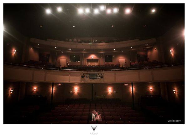 """""""€œKala and Danny have a second kiss in the seats of the Meroney Theater in Salisbury, North Carolina where they were married"""