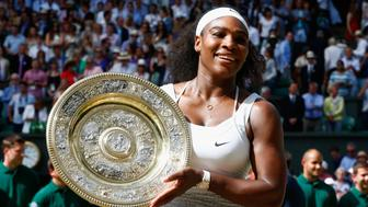 LONDON, ENGLAND - JULY 11:  Serena Williams of United States celebrates with the trophy after winning the Final of the Ladies Singles against Garbine Muguruza of Spain during the day twelve of the Wimbledon Lawn Tennis Championships at the All England Lawn Tennis and Croquet Club on July 11, 2015 in London, England.  (Photo by Julian Finney/Getty Images)