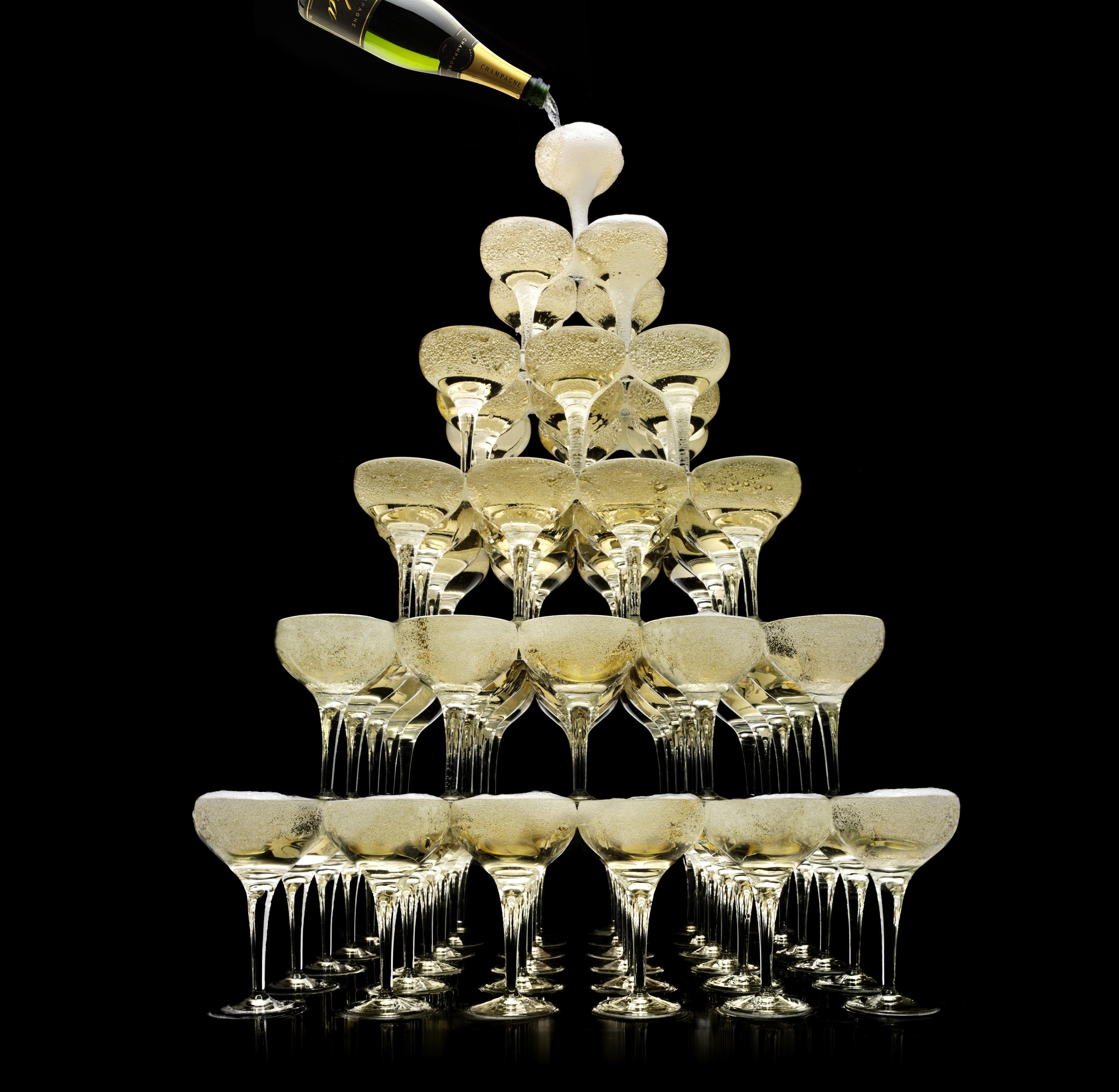 Tower of champagne glasses, studio shot