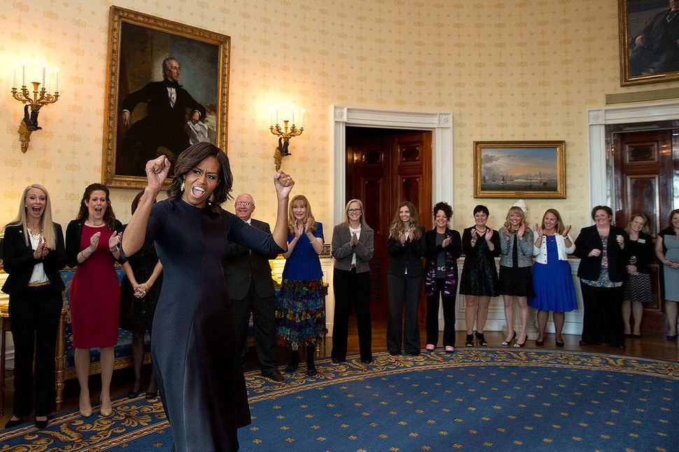 "First lady Michelle Obama cheers ""Counselor of the Year"" semi-finalists and finalists in the Blue Room prior to an event hono"