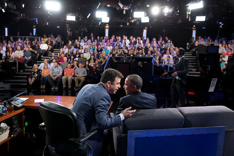"President Barack Obama talks with Jimmy Kimmel in between taped segments of ""Jimmy Kimmel Live!"" in Los Angeles on March 12,"
