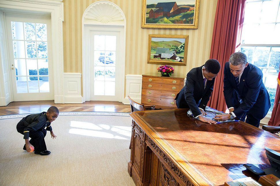 "President Barack Obama signs a poster for 13-year-old student Vidal Chastanet, who appeared on the ""Humans of New York"" blog,"