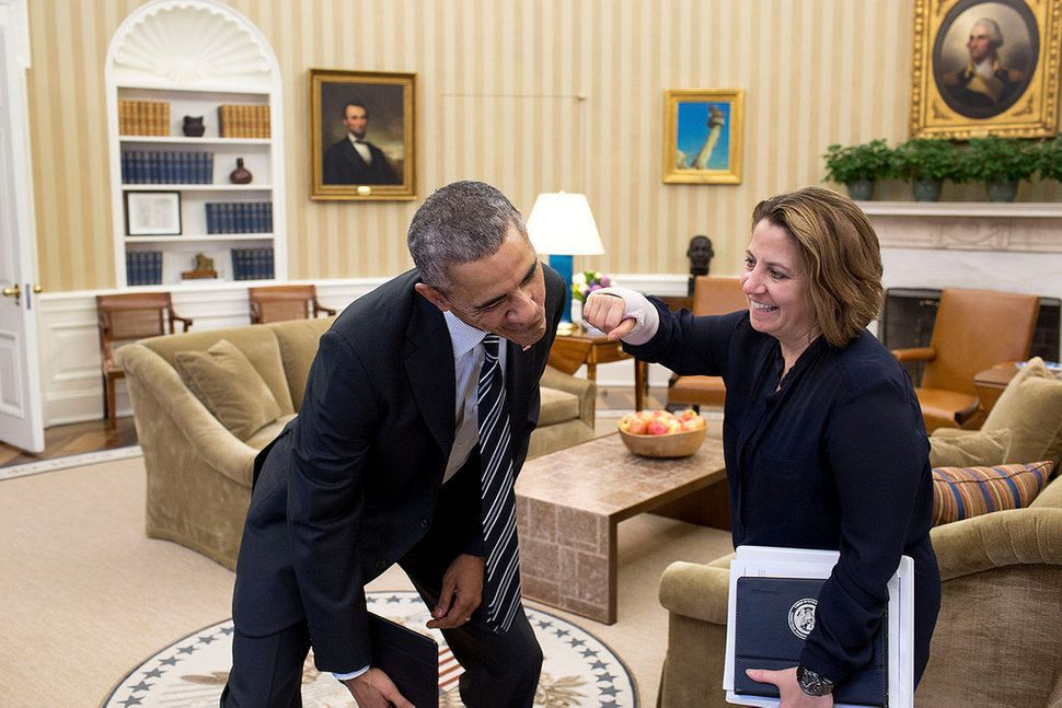 Lisa Monaco, assistant to the president for homeland security and counterterrorism, pretends to punch President Barack Obama