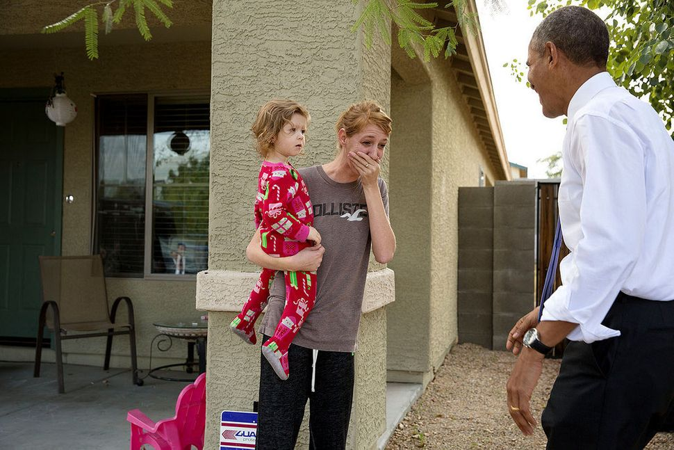 President Barack Obama greets neighbors after visiting a model home at the Nueva Villas at Beverly, a single-family housing d