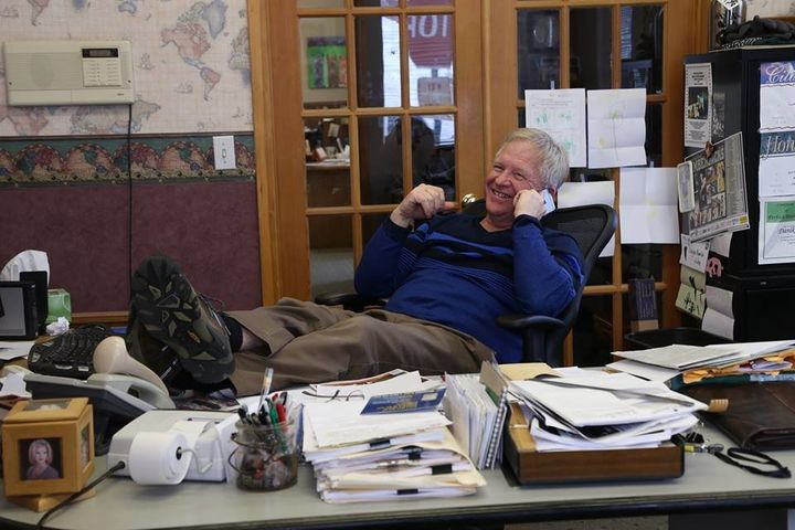 Dan Hammes, the editor and publisher of the St. Maries Gazette Record, sits in his office during a phone interview with
