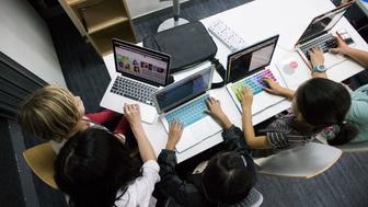 Students type on Apple Inc. laptop computers during a coding class at the First Code Academy in Hong Kong, China, on Friday, Nov. 13, 2015. About 2,500 students have taken courses at the First Code Academy. Photographer: Xaume Olleros/Bloomberg via Getty Images