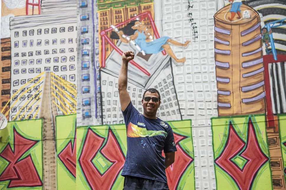 Fel and his mural.