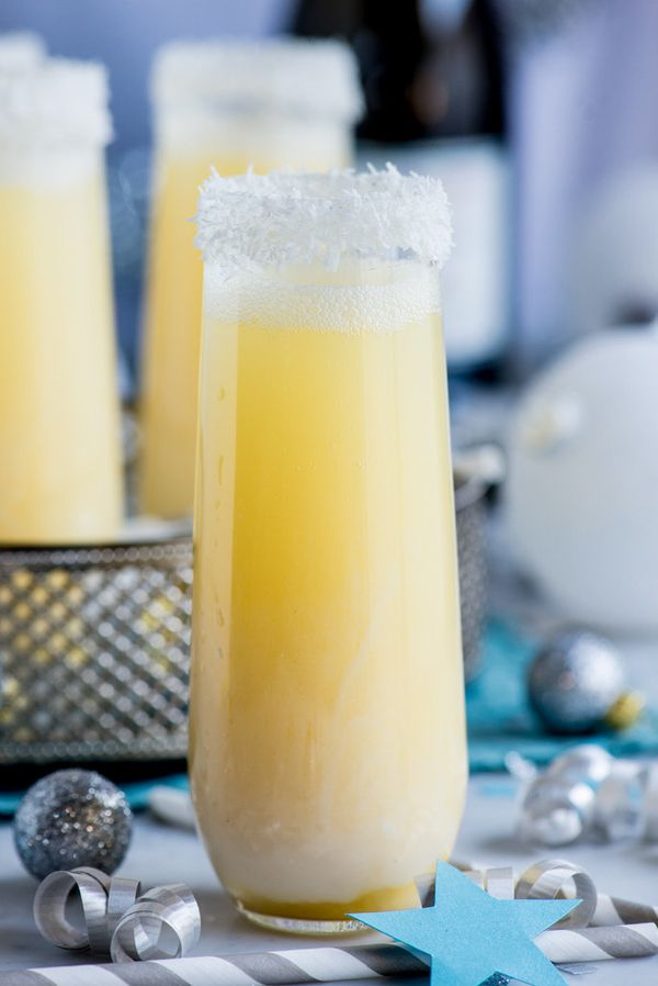 """<strong>Get the <a href=""""http://www.pineappleandcoconut.com/recipes/pineapple-coconut-champagne-cocktail/"""">Pineapple Coconut"""