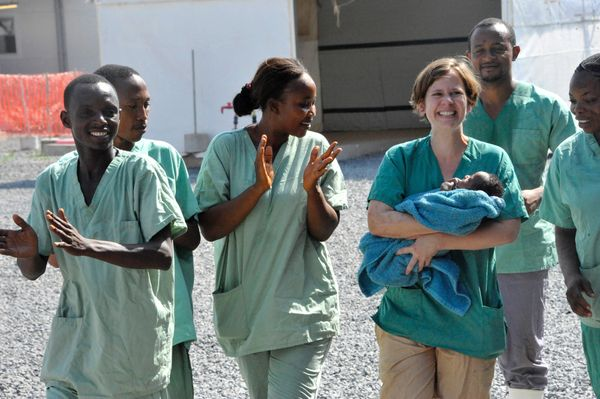 Medical workers present Noubia, the last known patient to contract Ebola in Guinea, during her release from a Doctors Without