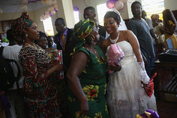 Bindu Quaye celebrates with friends at her wedding reception on Jan. 24, 2015, in Monrovia, Liberia. Like many couples, Quaye