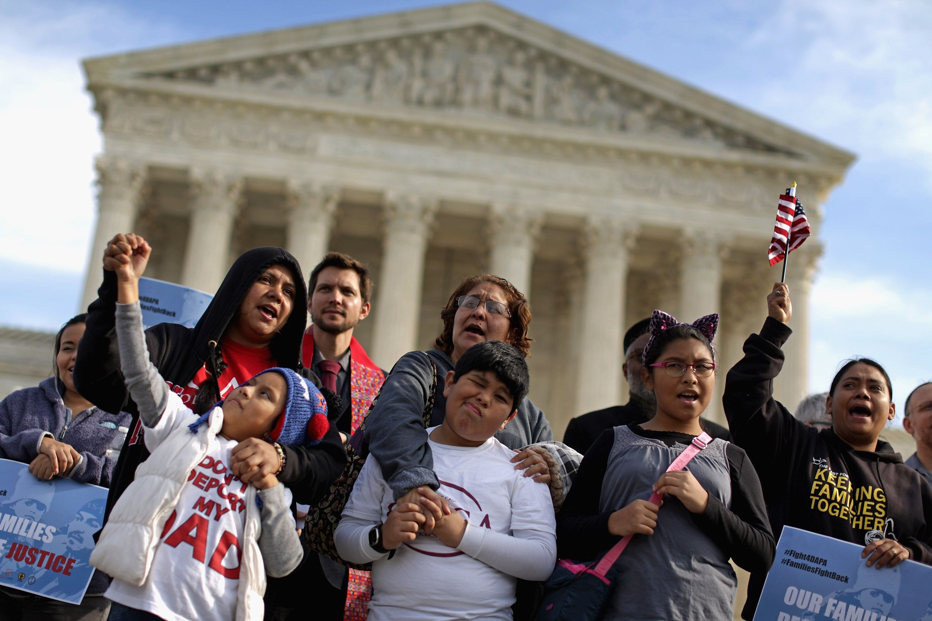 WASHINGTON, DC - DECEMBER 11:  Families chant 'Si se puede!' during a prayer vigil and rally in front of the Supreme Court December 11, 2015 in Washington, DC. Organized by The Fair Immigration Reform Movement (FIRM) and CASA, about 40 people gathered to pray for the Supreme Court justices after they agreed to hear a case regarding President Barack Obama's executive order to expand Deferred Action for Childhood Arrivals and implement Deferred Action for Parental Accountability.  (Photo by Chip Somodevilla/Getty Images)