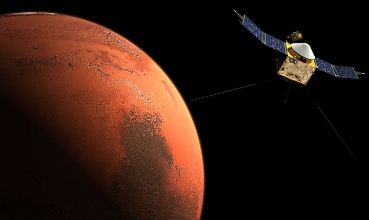 This image, courtesy of NASA, shows an artist concept ofMars and a spacecraft.