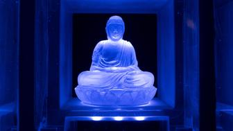 TOKYO, JAPAN - APRIL 06: A glass Buddha statue alter is seen lit up inside the Ruriden columbarium on April 6, 2015 in Tokyo, Japan. The Ruriden, operated by the Koukokuji buddhist temple, took two years to build and houses 2046 futuristic alters with glass buddha statues that correspond to drawers storing the ashes of the deceased. An IC card allows the owner of the alter to access the building and lights up the corresponding statue. The ashes are stored for 33 years before being buried below the Ruriden, currently 600 alters are in use and another 300 are reserved.  (Photo by Chris McGrath/Getty Images)