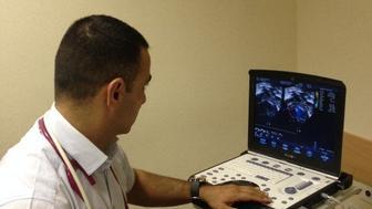 Dr. Abu Zahira at his clinic in Hebron.