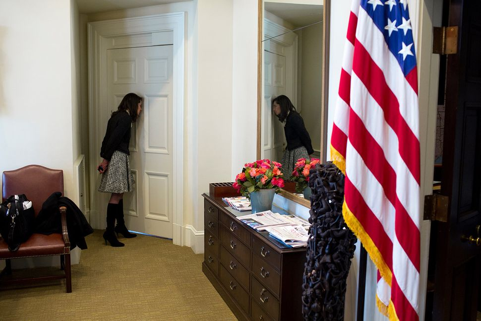 Natalie Jones, Acting Chief of Protocol, U.S. Department of State, looks into the Oval Office through a peephole during a bil