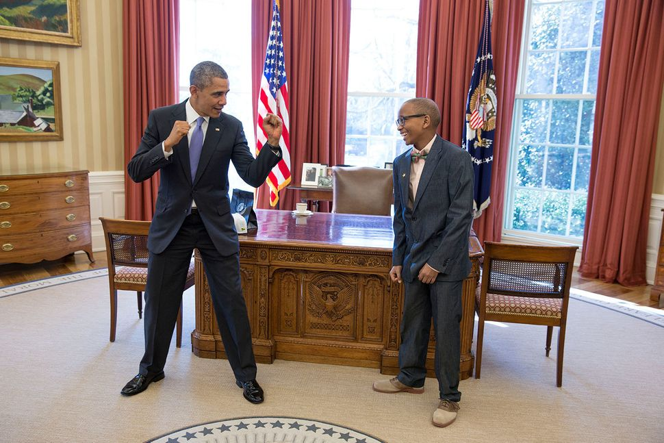President Barack Obama spars with Jaren Paul Suber, a 14-year-old Make-A-Wish recipient from Rowlett, Texas, in the Oval Offi