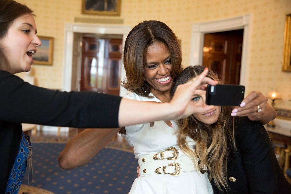 First Lady Michelle Obama and Sarah Jessica Parker pose for a selfie in the Blue Room prior to the White House Talent Show ho