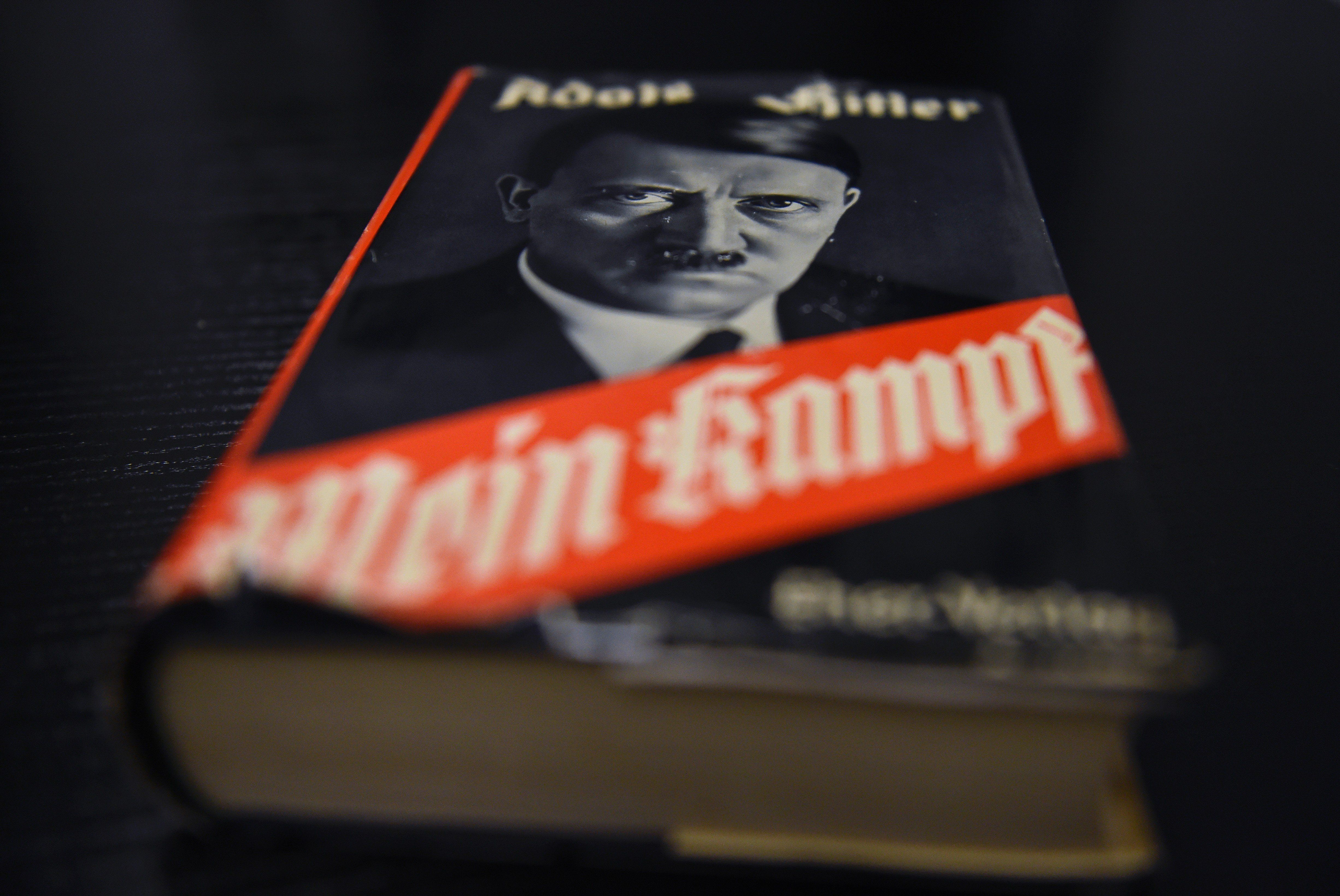 A German edition of Adolf Hitler's 'Mein Kampf' (My Struggle) is pictured at the Berlin Central and Regional Library (Zentrale Landesbibliothek, ZLB) in Berlin on December 7, 2015. For the first time since World War II, Adolf Hitler's 'Mein Kampf' will be printed in Germany in January 2016 as an annotated edition published by the Institute of Contemporary History (IFZ) in Munich.  AFP PHOTO / TOBIAS SCHWARZ / AFP / TOBIAS SCHWARZ        (Photo credit should read TOBIAS SCHWARZ/AFP/Getty Images)