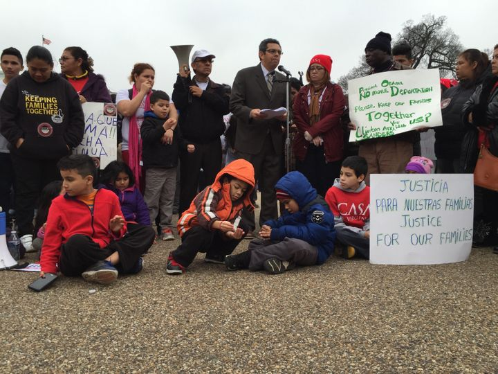 Children sit on the ground during a protest outside the White House over the Obama administration's plans to deport more fami
