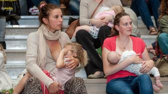 Women take part in a breastfeeding flashmob to campaign for mothers' rights to breastfeed their babies in public in Antwerp on September 12, 2015. AFP PHOTO / BELGA / JONAS ROOSENS == BELGIUM OUT ==        (Photo credit should read JONAS ROOSENS/AFP/Getty Images)