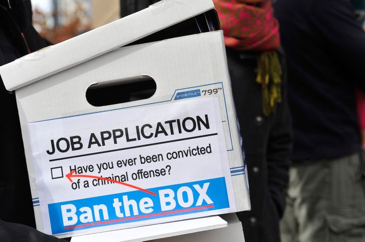 "Activists deliver a petition to the White House on Oct. 26, 2014, calling to ""ban the box"" that requires job applicants to st"