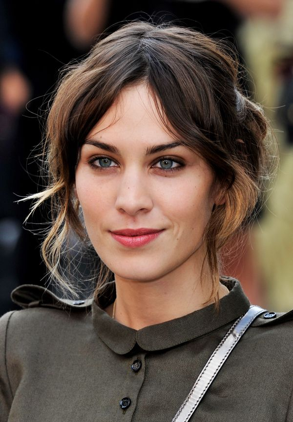 Alexa Chung attends the Burberry Prorsum Spring/Summer 2011 fashion show during LFW at Chelsea College of Art and Design in L