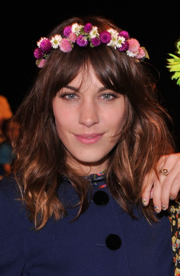 Alexa Chung attends the Anna Sui Spring 2013 fashion show during Mercedes-Benz Fashion Week at The Theatre in New York City.