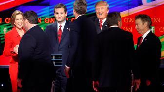 Republican presidential candidates, from left, Carly Fiorina, Chris Christie, Ted Cruz, Jeb Bush, Donald Trump, John Kasich and Rand Paul talk together following the CNN Republican presidential debate at the Venetian Hotel & Casino on Tuesday, Dec. 15, 2015, in Las Vegas. (AP Photo/John Locher)