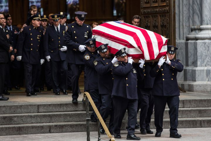 The casket carrying Joseph Lemm is carried out of St. Patrick's Cathedral.