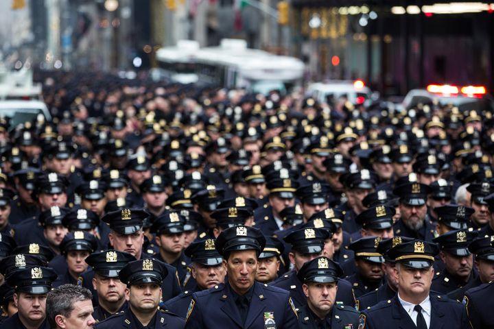 Law enforcement officials attend the funeral of Joseph Lemm.