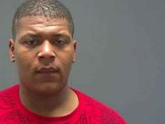 Laquinton Banks, 25, faces charges of felony theft, malfeasance in office and hate crimes.