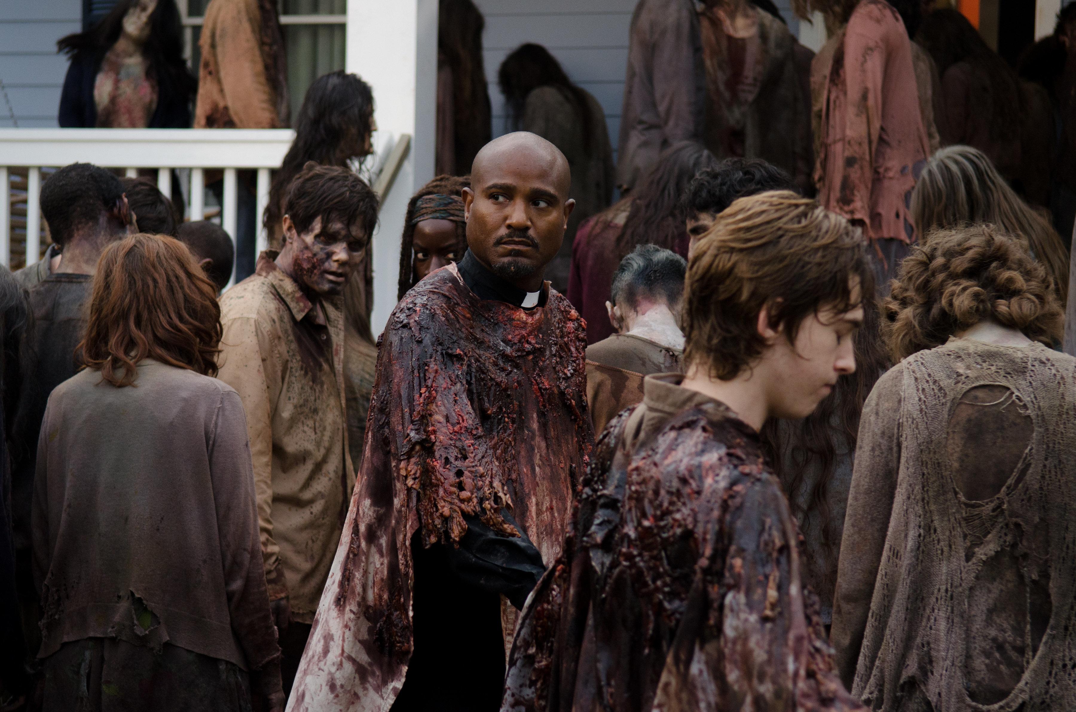 "Father Gabriel (Seth Gilliam) surveys the scene in a Season 6 episode of ""The Walking Dead."""