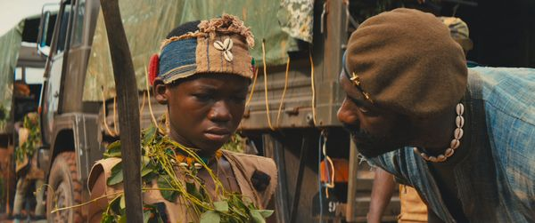 """Beasts of No Nation,"" Netflix's first original film, is the searing portrait of a West African child soldier (Abraham Attah)"