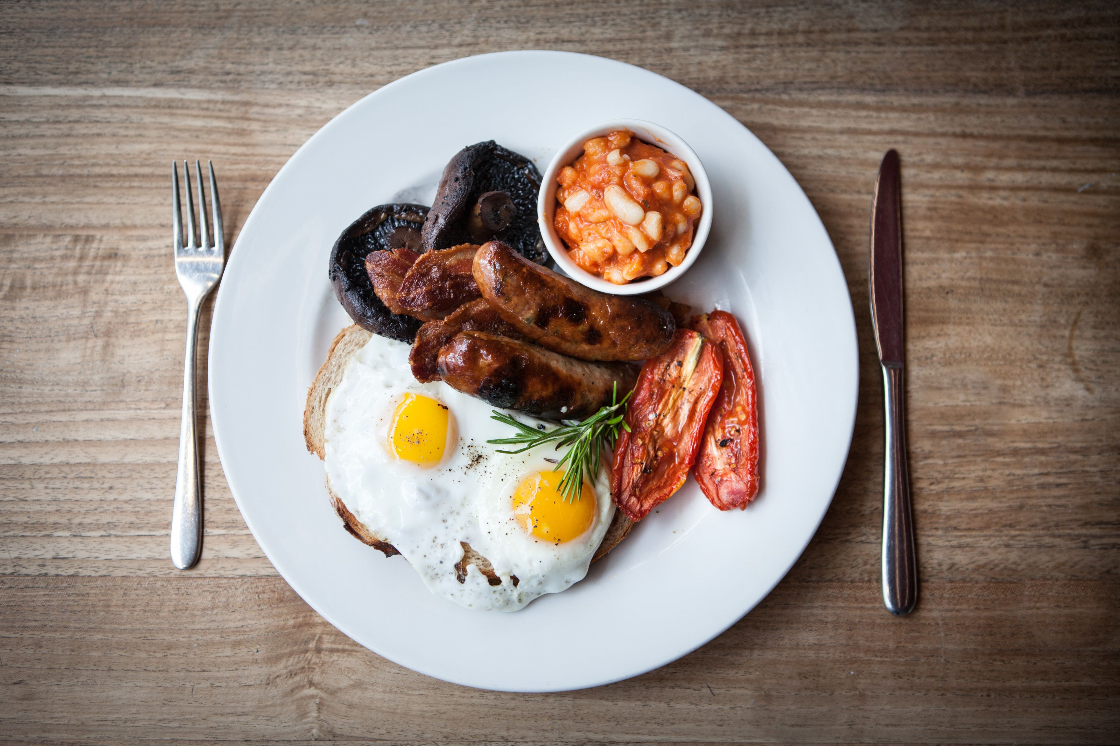 Gorging on heavy food, such as the classic English Breakfast, with eggs, sausage, mushrooms, toast, tomatoes and beans, have