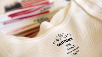 The Old Navy brand label is seen on a woman's white tank top at the Gap Inc. Old Navy store in San Mateo, California, U.S., on Wednesday, June 29, 2011. Old Navy's revamped stores have helped the retailer boost sales after years of decline. Photographer: David Paul Morris/Bloomberg via Getty Images    EDITOR'S NOTE: *** PHOTOS EMBARGOED UNTIL 00:01 MONDAY, JULY 11, 2011 ***