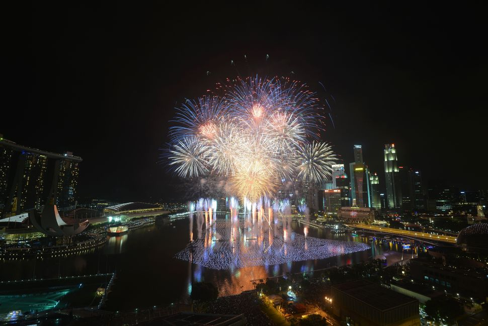 Fireworks burst over the Marina Bay in Singapore on Jan. 1, 2016, to mark New Year's celebrations.