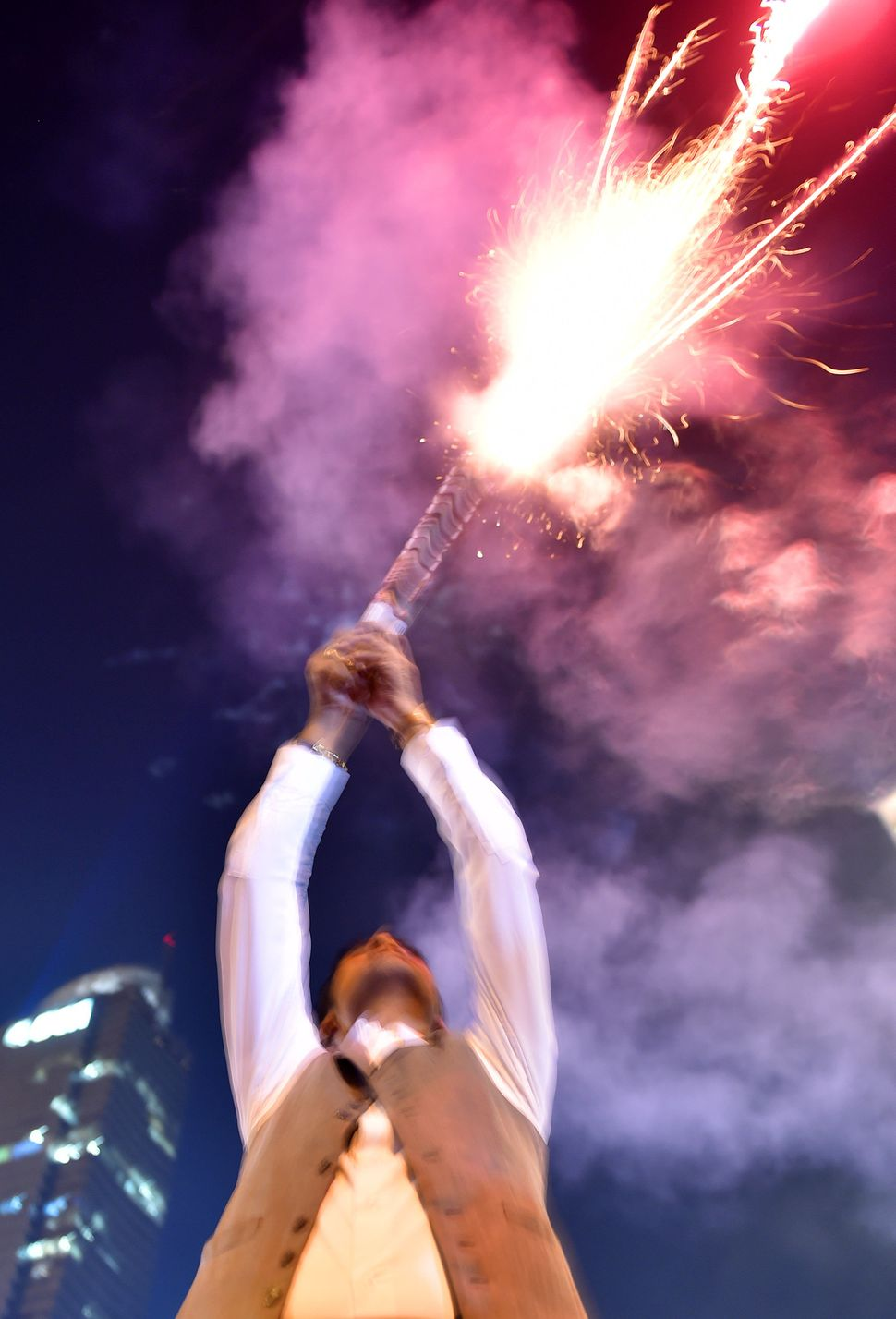 A man fires a firework during a countdown event to celebrate the new year in Jakarta on Dec. 31, 2015.