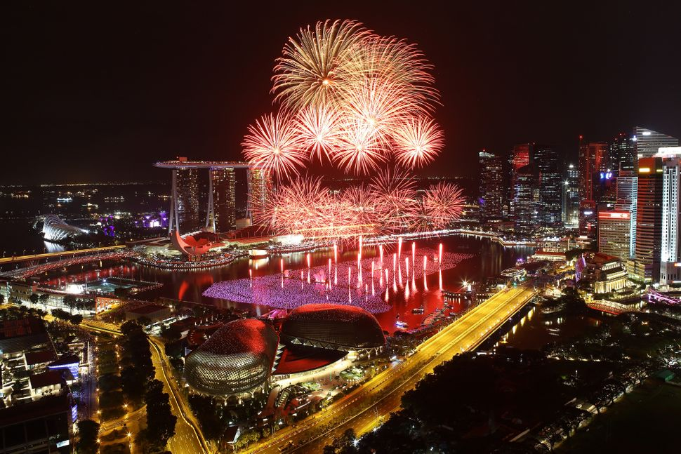 Fireworks explode over the Esplanade and Marina Bay Sands as Singapore celebrates the new year at Marina Bay on Jan.1,