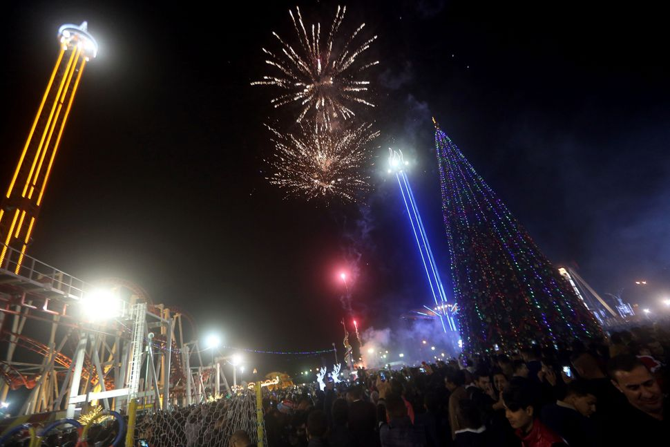 Fireworks explode in the Zawra Park during New Year's Eve celebrations in the Iraqi capital, Baghdad, on Dec. 31, 2015.