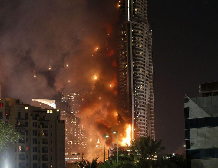 The AddressDowntown Dubai hotel stands across the famous Burj Khalifa tower.