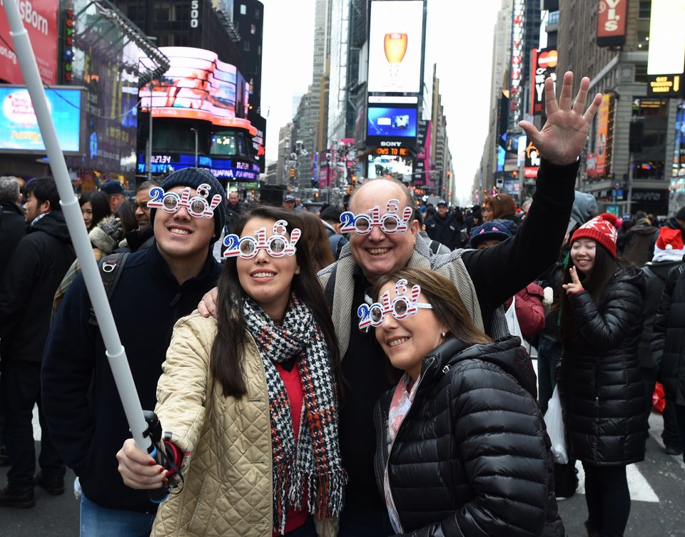 2016 is written all over these revelers faces as they take selfies ahead of the ball drop in Times Square.